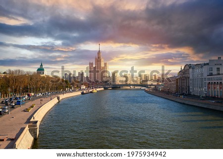 Selective focus. Moscow. Russia. House on Kotelnicheskaya embankment and  Zaryadye Park on left side.  Life before pandemic COVID-19 Stock photo ©