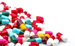 Selective focus of antibiotic capsules pills on blur background. Drug resistance concept. Antibiotics drug use with reasonable.. Pharmacy drugstore background. Pharmaceutical industry. Pharmaceutics.