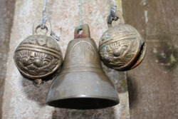 Selective focus of brass hanging bell with Chinese Fengshui, traditional lucky Tibet tiger head brass sleigh bells