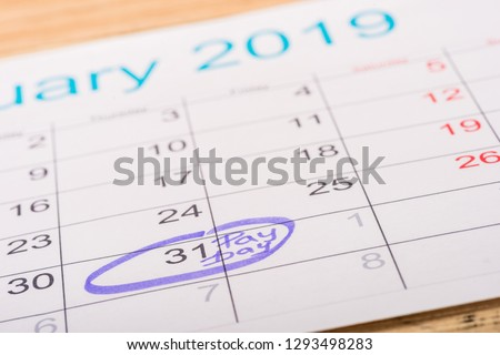 selective focus of calendar with marked number 31 and 'pay day' lettering