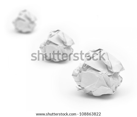 Selective focus of close-up of crumpled paper ball with white background.