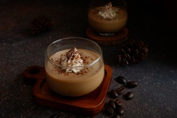 selective focus of coffee and chocolate panna cotta dessert in dark background