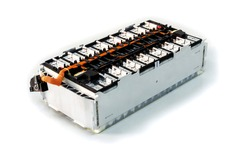 Selective focus of Electric car lithium battery pack and wiring connections internal between cells on background.