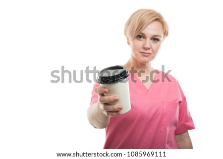 a5af74760b4 Selective focus of female nurse wearing pink scrubs holding coffee isolated  on white background with copyspace