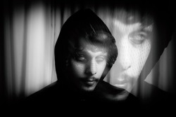selective focus of indian men with his eyes rolled, double exposure effect, trippy conceptual photo, black and white.