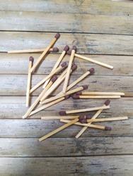 Selective focus of Korek api kayu are wooden lighters. Wooden matches. Matchsticks. Matches. On bamboo background.