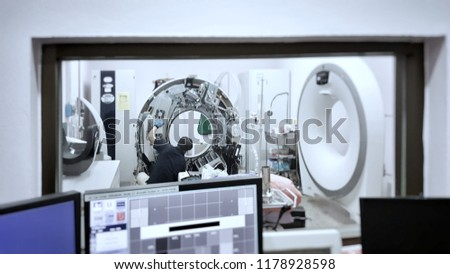 Selective focus of Maintenance engineer repairing and checking CT scanner machine in the hospital. Medical maintenance concept.  #1178928598