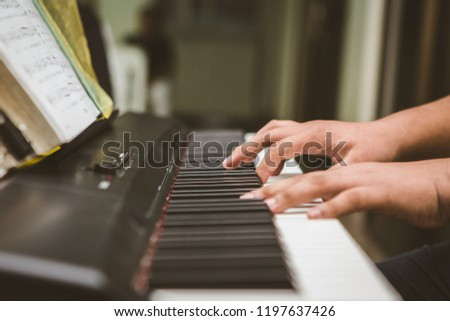 Selective focus of Man hand playing piano #1197637426