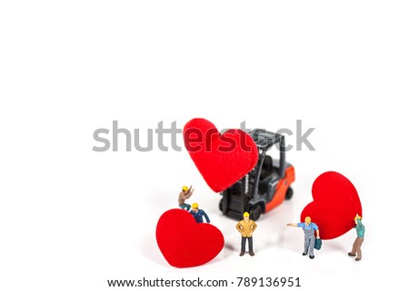 selective focus of miniature workers holding red heart shape by fork truck isolated on white background , abstract background to valentine concept. #789136951