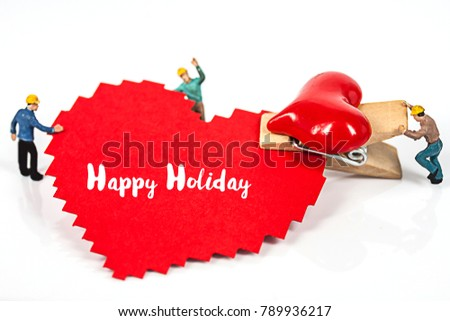 selective focus of miniature workers holding red heart shape wood clip isolated on white background , abstract background to valentine concept. #789936217
