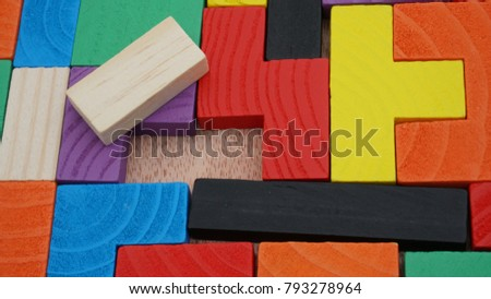 Selective focus of multicolored wooden jigsaw bricks relating to problem solving at early stage of education #793278964
