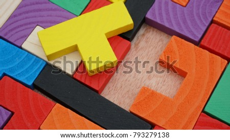 Selective focus of multicolored wooden jigsaw bricks relating to problem solving at early stage of education #793279138