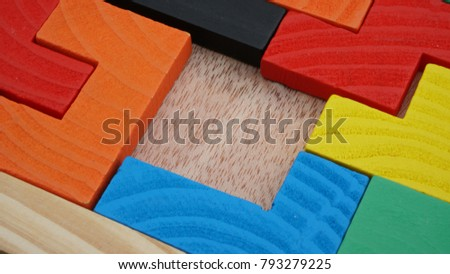 Selective focus of multicolored wooden jigsaw bricks relating to problem solving at early stage of education #793279225