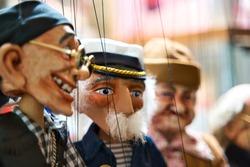 Selective focus of old sailor Puppets hanging at the souvenir store. Prague. Souvenir puppets (Marionettes)