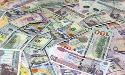 selective focus of Saudi Arabia currency with USA currency and Egypt currency banknotes. blurred money . Saudi Arabia riyals, Egyptian pounds and American dollars exchange rate.