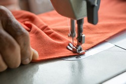 Selective focus of Sewing machine and blurred hands and copy space