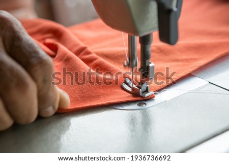 Selective focus of Sewing machine and blurred hands and copy space Foto stock ©