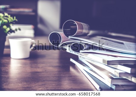 selective focus of the stacking magazine place on table in living room