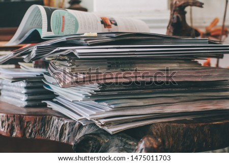 selective focus of the stacking magazine place on table in living room,Colorful abstract background image of stacked magazines. #1475011703