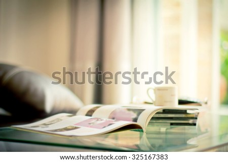 selective focus of the stacking magazine place on table in living room , extremely shallow DOF