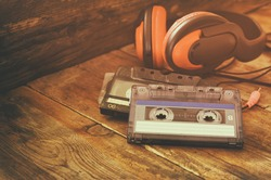 selective focus of top view of vintage headphones and cassettes