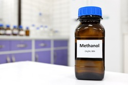 Selective focus of toxic methanol or methyl alcohol in glass bottle inside a laboratory.