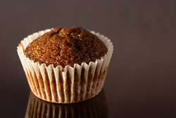 selective focus on a homemade cup cake muffin on glossy reflecting surface