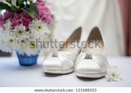 selective focus on accessory of the wedding shoes with flower on the left side