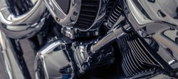 Selective focus on air filter of motorcycle. Shiny chrome motorbike engine detail. Closeup vintage motorbike parts. Motorcycle industry.