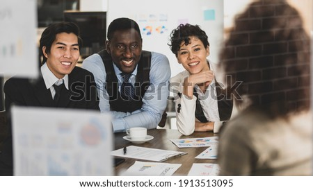 Selective focus on Attendee. Businesswomen explaining the attendees snilling and Clap your hands on a board, having graph papers at the conference room in the office. Concept meeting teamwork