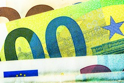 Selective focus on detail of EURO banknotes. Close up macro detail of EURO banknotes. World money concept, inflation and economy concept