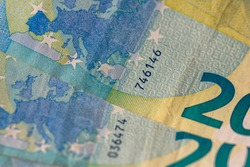 Selective focus on detail of EURO banknotes. Counting or giving EURO banknotes. World money concept, inflation and economy concept