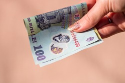 Selective focus on detail of LEI banknotes. Counting or giving Romanian LEI banknotes. World money concept, inflation and economy concept