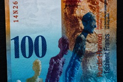 Selective focus on detail of 100 swiss franc banknote. Close up macro detail of money banknotes, swiss franc isolated. World money concept, inflation and economy concept