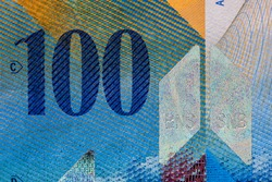 Selective focus on detail of 100 swiss franc banknote. Close up macro detail of money banknotes, swiss franc isolated.