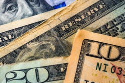 Selective focus on detail of USD banknotes. Close up macro detail of United States Dollars banknotes. World money concept, inflation and economy concept