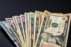 Selective focus on detail of USD banknotes. Detail of United States currency USD banknotes. World money concept, inflation and economy concept
