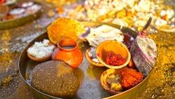 Selective focus on devotee devotional plate ornamented with sacred food Kheer, Puri. Sacred worship plate for Navratri or Ramnavmi festival.