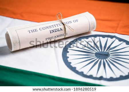 Selective focus on flag, Indian constitution or Bharatiya Savidhana preamble old scattered text paper placed on Indian flag - Concept of Freedom, Nationality and patriotism Stockfoto ©