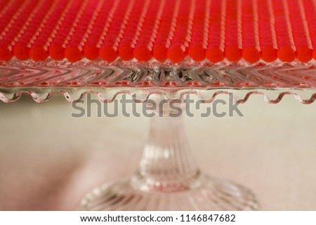 selective focus on glass container for a large group of red spheres lined #1146847682