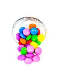 Selective focus on  multicolored Gems chocolate on white background