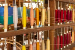 Selective focus on silk threads yarn, handicrafts weaving textile productions in Thailand