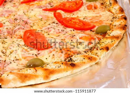 Selective focus on the first piace of the pizza
