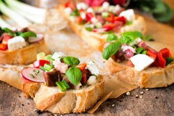 Selective focus on the front bruschetta with spring salad