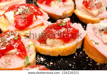 Selective focus on the middle bruschetta
