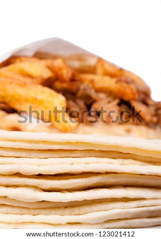 Selective focus on the tortilla with gyros on it