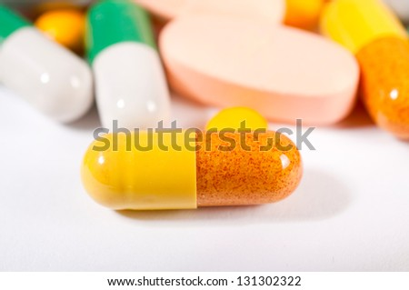 Selective focus on the yellow pill
