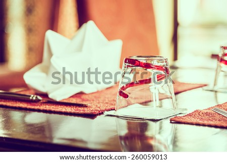 Selective focus point on glass in restaurant - vintage effect style pictures