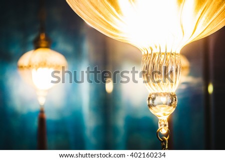Selective focus point on Morocco light lantern decoration in living room interior - Vintage Light Filter