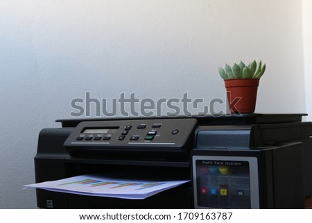 Photo of  Selective focus Printer. Closeup laser printer or scanner. Business man press button on panel of printer in office. Working in office. Office equipment. Printer in office for working space concept.